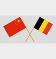 the crossed belgium and china flags vector image vector image