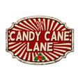 candy cane lane vintage rusty metal sign vector image