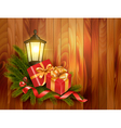 Christmas background with presents and a lantern vector image