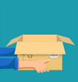 delivery man or courier holds an open box vector image vector image