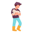 kid holding lamb in hands farming child vector image