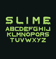 slime font alphabet with green flow drops and goo vector image