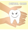 Hands holding a healthy tooth vector image vector image