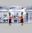 professional chefs couple holding trays with fresh vector image vector image