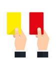 soccer referees hand with red and yellow card vector image vector image