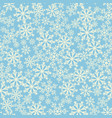 seamless blue background with snowflakes pattern vector image
