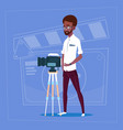 african american man holding camera on tripod vector image vector image