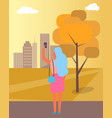 woman taking picture of city vector image