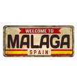 welcome to malaga vintage rusty metal sign vector image