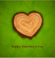 Wooden heart on green background vector image