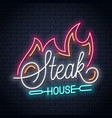 steak house neon logo with fire on black vector image
