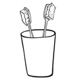 Toothbrushes inside a glass vector image vector image