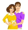 husband touching the belly of his pregnant wife vector image vector image