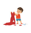 cute little bully boy cutting red mothers dress vector image vector image