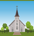 church standing on a lawn surrounded by trees vector image