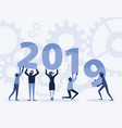 happy new year 2019 text hold by team vector image