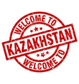 welcome to kazakhstan red stamp vector image vector image
