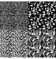 set of black and white floral seamless patterns - vector image