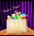 trick-or-treat paper bag full of goodies sweets vector image