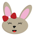 smiling beige rabbit with red bow on white vector image vector image