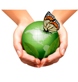 Green world with leaf and butterfly in woman hands vector image
