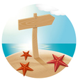 guidepost at the beach with the sea stars