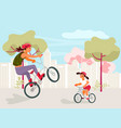 mother and daughter riding bikes vector image vector image