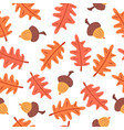 seamless autumn leaves and acorns pattern vector image