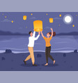 smiling couple on a date at sky lantern festival vector image vector image