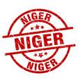 niger red round grunge stamp vector image vector image