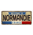 welcome to normandie vintage rusty metal sign vector image
