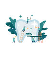 group small dentists caring for large tooth vector image vector image