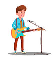 young handsome guy singing into microphone on vector image