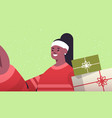 happy woman with gifts holding camera and taking vector image