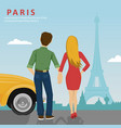 young couple looking at eiffel tower in paris vector image vector image