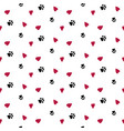 seamless background with hearts and dog footprint vector image