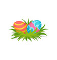 two painted eggs on green grass happy easter vector image vector image