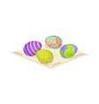 four easter eggs with ornaments on fabric napkin vector image