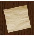 Piece of old paper on wooden texture background vector image