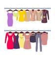 racks with female tops and dresses on hangers vector image