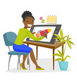 A black woman graphic designer works at the office