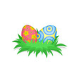 two cute painted eggs in green grass happy easter vector image