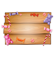 An empty signboard with candies vector image vector image