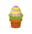 painted easter egg in ceramic pot with green grass vector image vector image