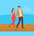 young couple walks on field in countryside vector image