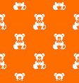 teddy bear holding a heart pattern seamless vector image vector image