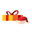 christmas gift box and santa hat vector image