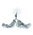 man stands on top of mountain with torch in hand vector image