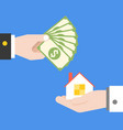 hand holding banknotes and hand carrying house vector image