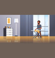 man ironing clothes african american guy holding vector image vector image